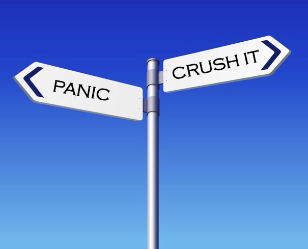Street signs with two choices: panic or crush it.