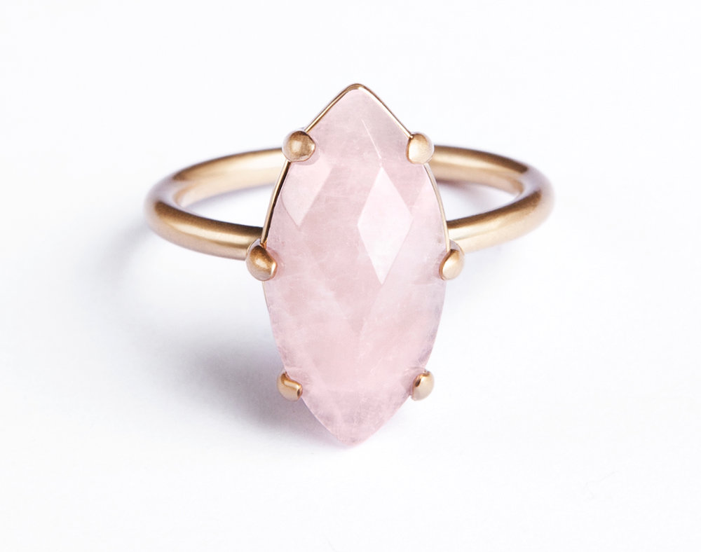 STELLA RING - The Stella ring is a study in minimalist beauty and the power of simplicity. Obvious and bold, like a night sky star, this ring features a centered hand-cut rose quartz. Stacked or by itself, this is the perfect add-on to your ring party. 18k antiqued gold plated, hand-cut rose quartz size 6 natural gemstone's inclusions may differ from piece to piece to allow for a signature one-of-a-kind aesthetic. Made with love.