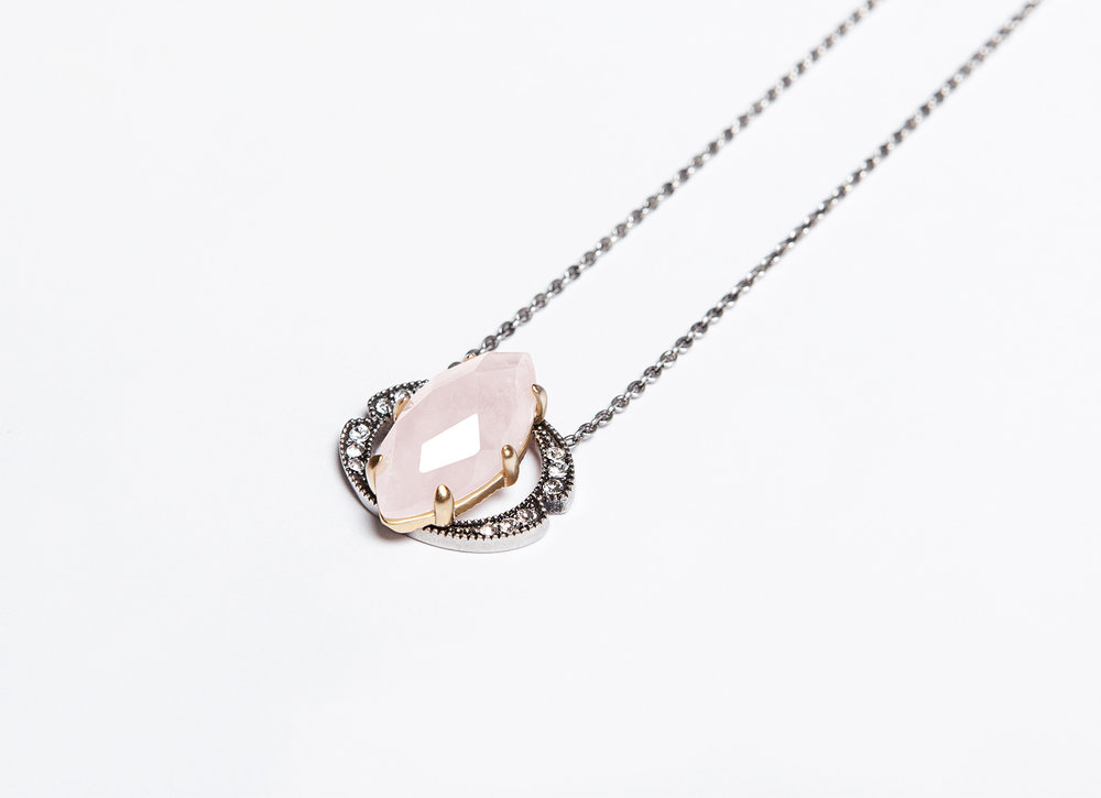 MIRA NECKLACE - Mira, the mysterious pink star, nominates this necklace. Dainty and elegant, yet with an edgy flair. Its bi-tonal palette of soft rose and light silver hues can complement and enhance any skin tone, making this piece not only one of the designer's favorite but an absolute must have. 18k antiqued gold-plated, antiqued silver-plated, rose quartz, swarovski crystals measures 17