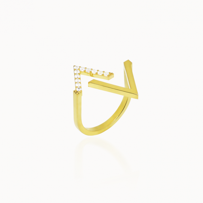 FRACTURE TRIANGLE RING - 14k gold plated. Swarovski crystals. Highly polished. 0.5 inches long. The evolution of the asymmetry circle, the fracture ring decomposes a perfect shape to create something unique. Wear it in the daytime to style up your work wardrobe or add it to your party outfit and enjoy the glamorous shimmer of the swarovski crystals.