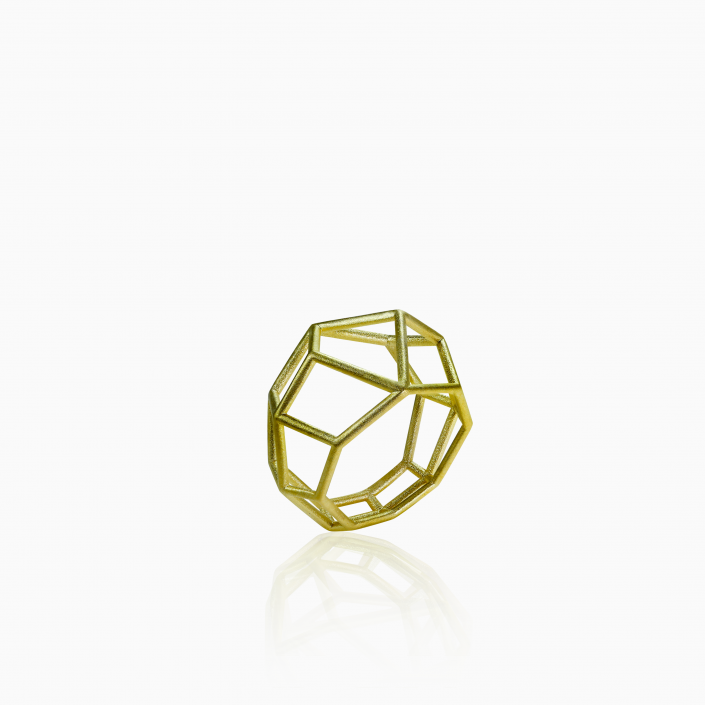 TETRA RING - 14k gold plated. Satin finished. 0.7 inches long. The tetra ring is a complex architecture perfect for those who think outside the box. It is a statement piece that gives character and innovation to your outfit. The clean shapes of the cage necklace make it the perfect jewel for every occasion.