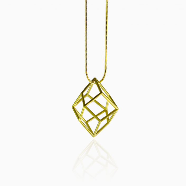 TETRA NECKLACE - 14k gold plated. Satin finished. 1.3 inches long. The Tetra necklace is a complex architecture perfect for those who think outside the box. It is a statement piece that gives character and innovation to your outfit. The clean shapes of the cage necklace make it the perfect jewel for every occasion.