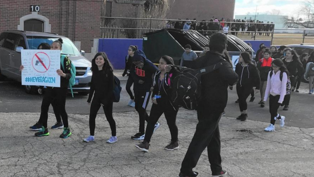 Abbott Middle School students participate in a walkout Thursday, Mar. 8 inspired by the #NeverAgain movement organized in the wake of a shooting at Marjory Stoneman Douglas High School in Parkland, Fla., that left 17 people dead. Photo lifted from Chicago Tribune, courtesy of Waukegan School District 60