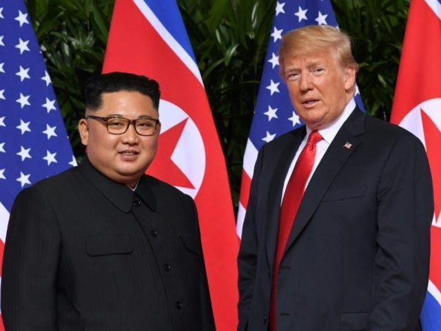 Kim Kong-un and Donald Trump stand in front of flags made in China.