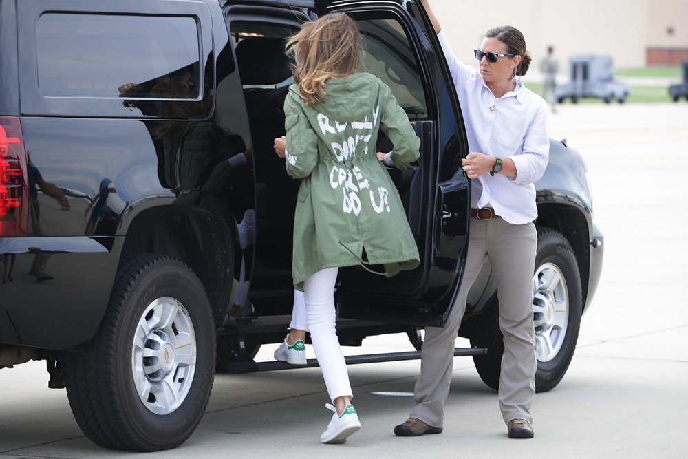 """The First Lady leaving after visiting a facility that is holding immigrant children. Her fashion-forward coat (in Texas, nonetheless) reads """"I really don't care, do you?"""" But it's just fashion, not a message, she claims."""