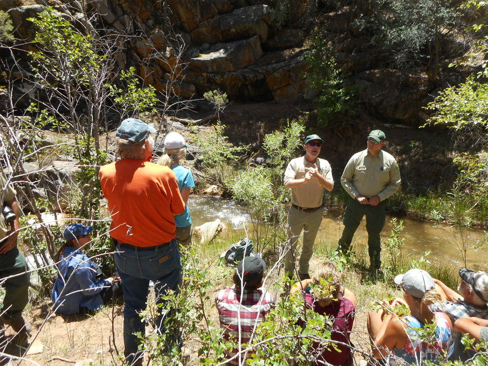 Matt Dare of the U.S. Forest Service speaks to citizens on an Uncompahgre Plateau field trip. Partners plan to install a barrier to keep non-native rainbow trout from interbreeding with native greenback cutthroat trout.