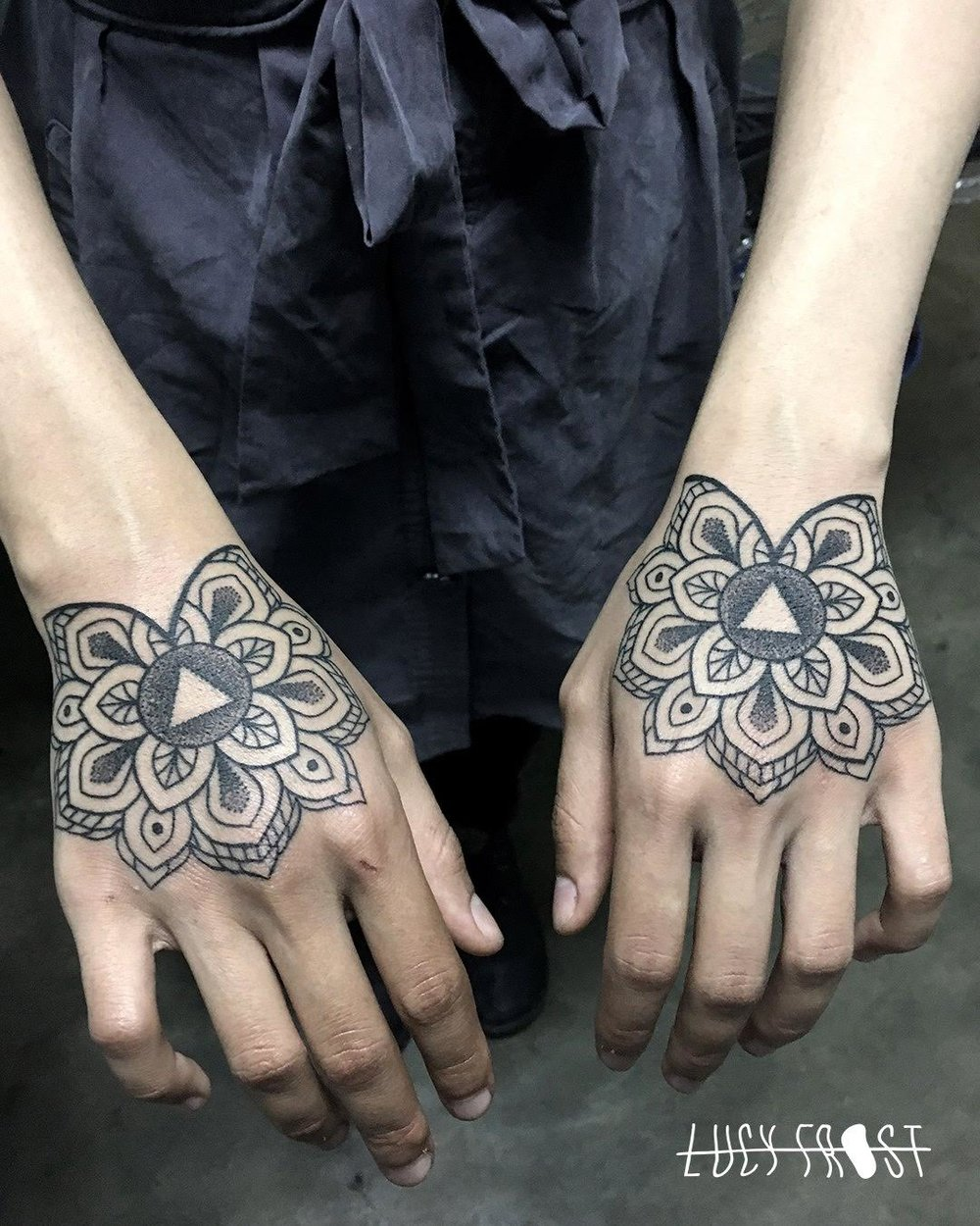 lucy frost  hands tattoo.jpg