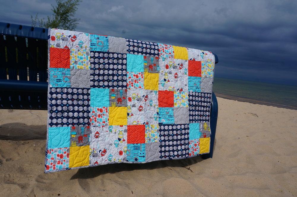 I love it when people put their quilts to use, especially on the beach