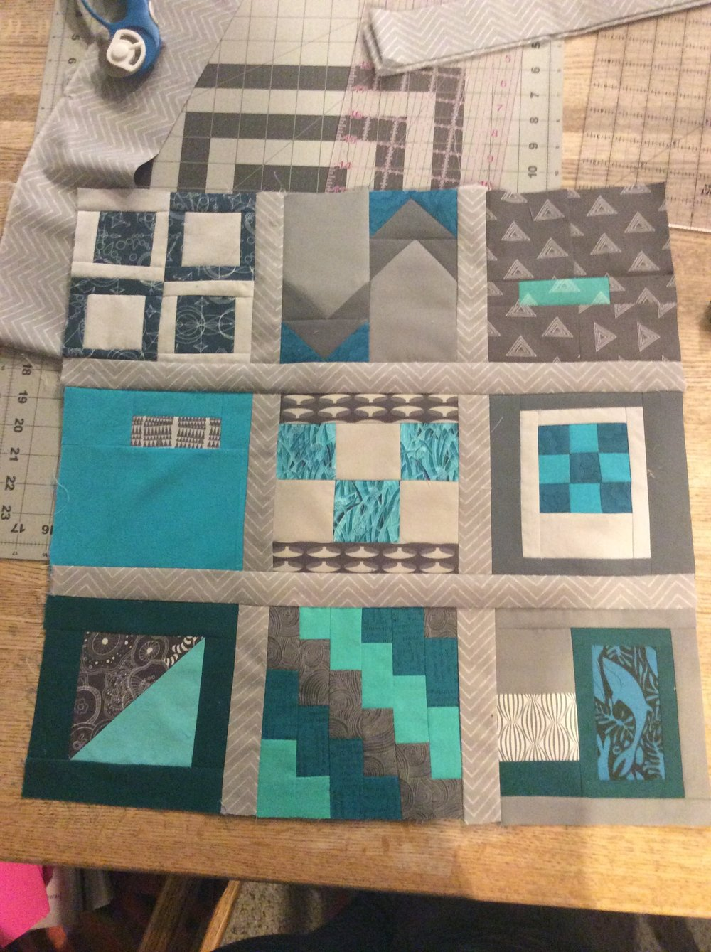 Working on a secret stalker quilt, front is done but who boy is the quilting intimidating me.