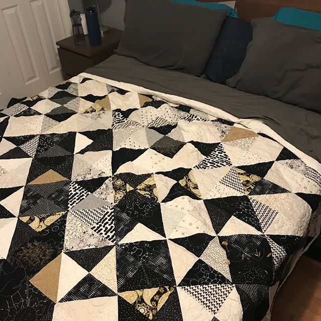 I love when people I make stuff for send me photos of it in use. I told this person that it was meant to be used, not looked at and they were surprised, but I am insistent. It looks wonderful, if I do say so myself.  #modernquilting #blackandwhite #nlack #white #gold #quilt #quilting