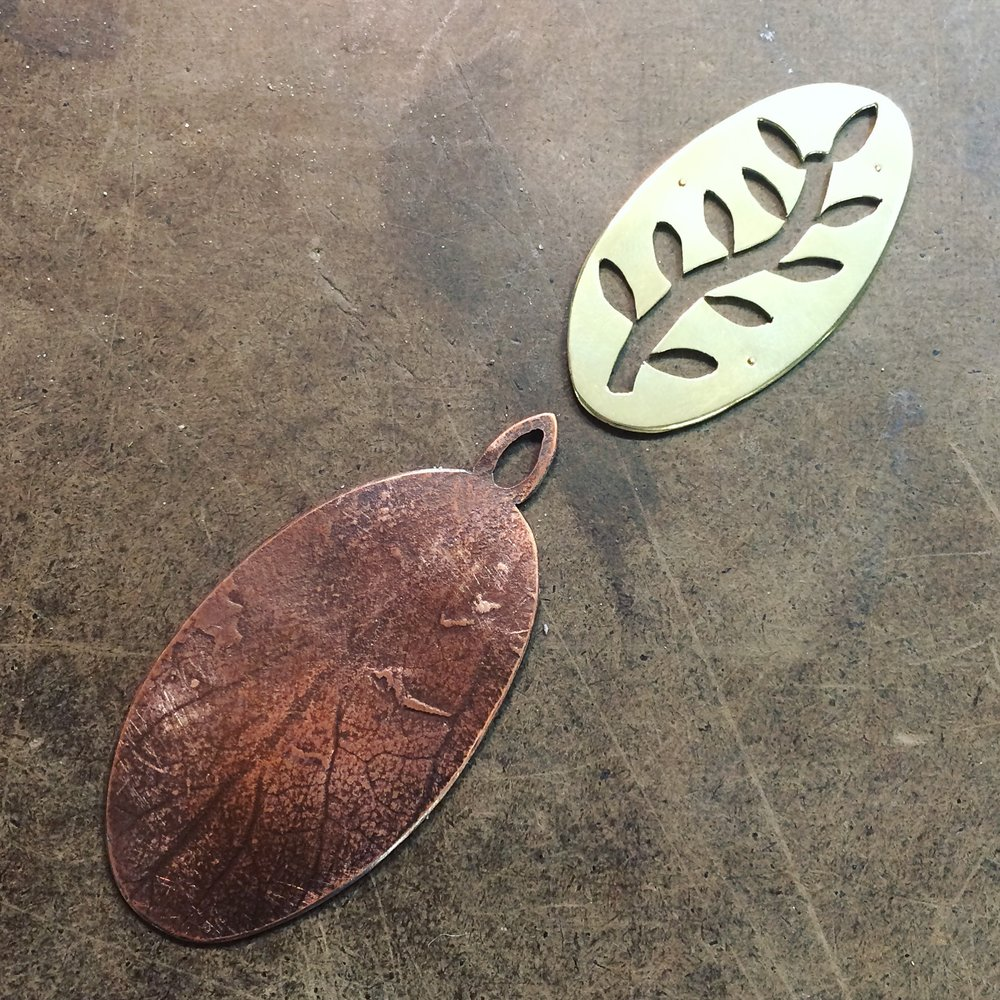 Student's copper and brass pendant in progress.