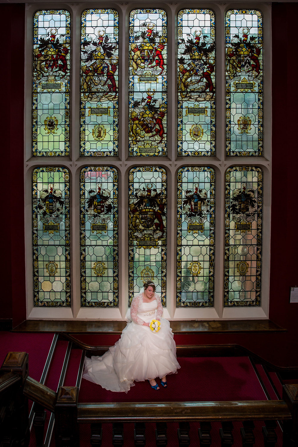 The main staircase and stained glass window make for stunning images.