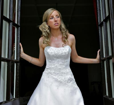 Bride emerging from doorway