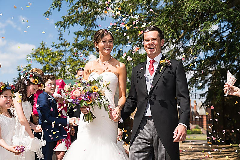 Bride & Groom with confetti at wedding