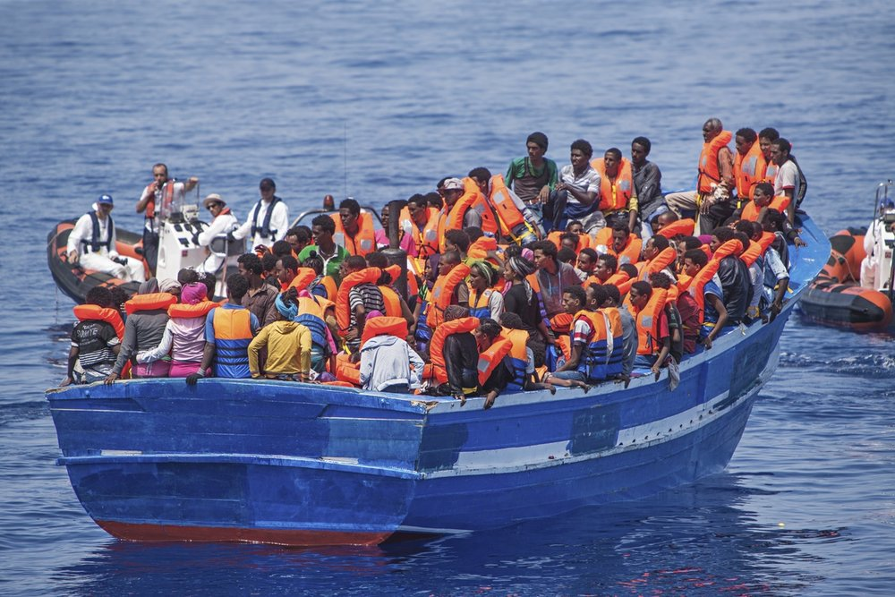 "Strait of Sicily, September 2, 2015. Eritrean refugees, who were rescued at sea by a ship named ""Phoenix,"" which was patrolling near the Libya coasts when the two drones found 3 wooden fishing boats."