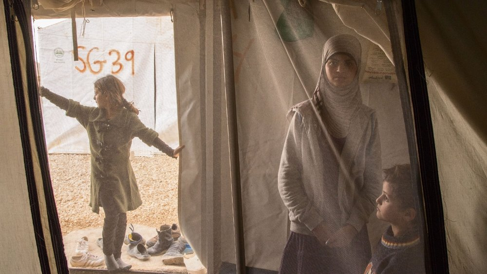 Reem, 13, spends time wither her siblings in her family tent at the Al Za'atri refugee camp for Syrians, near Mafraq, Jordan on Nov. 18, 2013. Reem is a Syrian refugee suffering from mental health issues. While she was in Syria, Reem witnessed several armed conflicts, killing, bombing and kidnapping. She has been living in a tent at the Za'atri camp wither her family since January 2013.