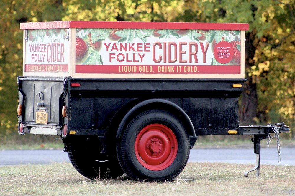 YANKEE FOLLY CIDERY - It started over 50 years ago with Eric's grandfather Jack Lueken, his partner Raymond Jenkins, and just a few trees and five varieties. They soon became a local favorite. Today, the Orchard has expanded to thousands of trees and over 40 apple varieties. Of these varieties is the distinctive and highly acclaimed Golden Russet that Jack Lueken himself brought over from Germany.  This rare apple with its distinguished taste is unlike any other and is just one of the many varieties that is hand-selected and pressed to create the unique blend that you can enjoy in our cider today.Find Yankee Folly Cider at the Farmer's Market Grounds on the Craft Market Walk!