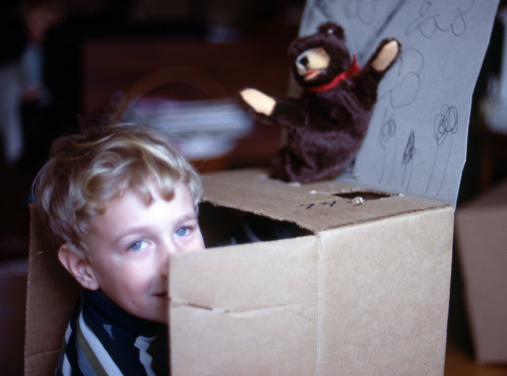 Brian Henson performing in his cardboard box puppet theater.