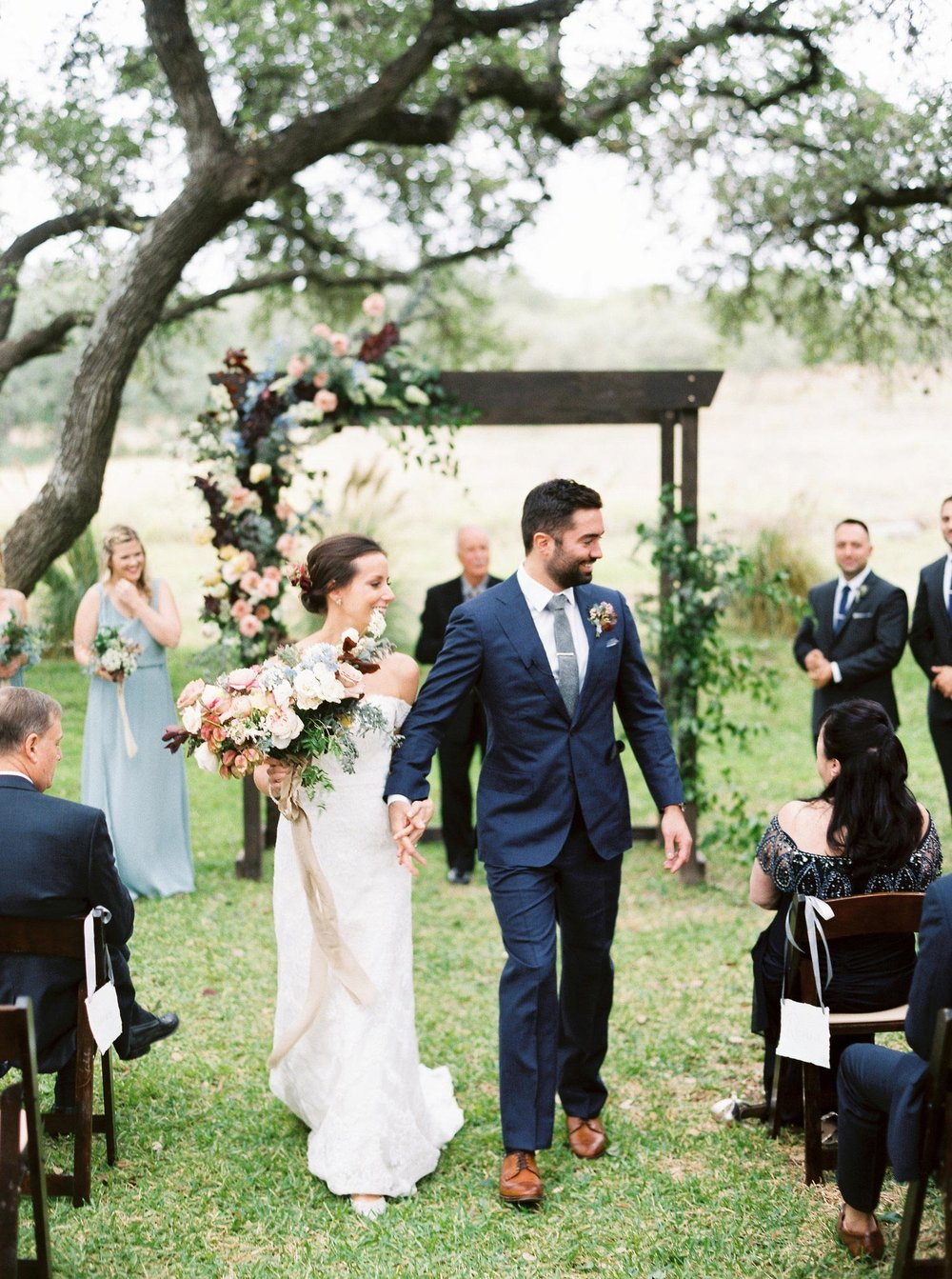 f555022c629 Newly wed couple walks the aisle with bridal bouquet by Color Theory  Collective
