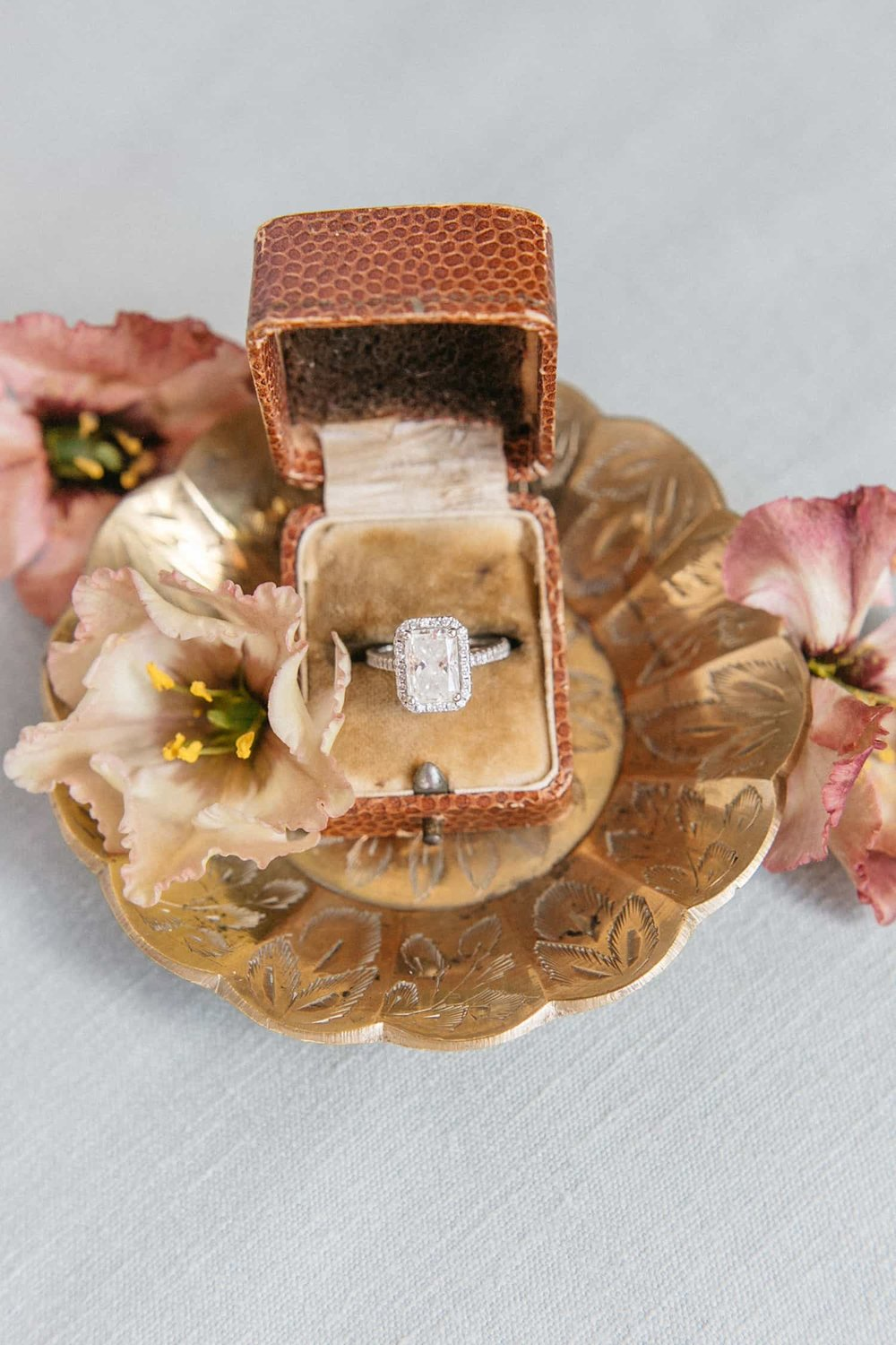 Wedding ring & flowers by Color Theory Collective