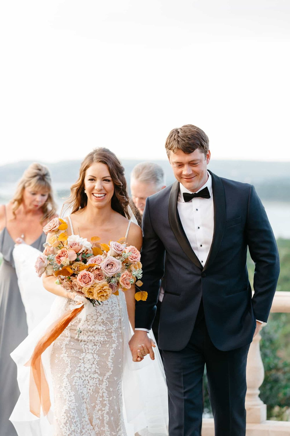 Bride with bridal bouquet by Color Theory Collective