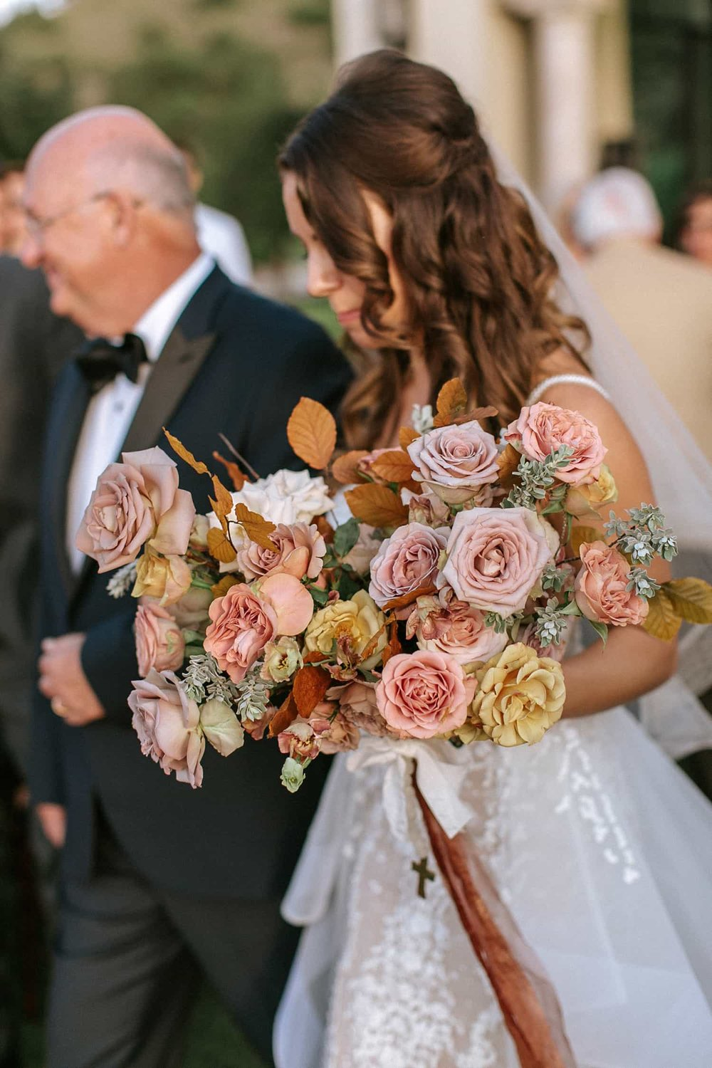 Bride with bridal bouquet flowers by by Color Theory Collective