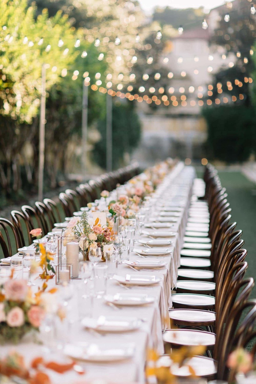 Flowers at wedding reception by Color Theory Collective