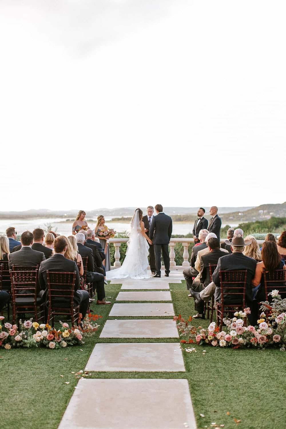 Wedding ceremony flowers by Color Theory Collective