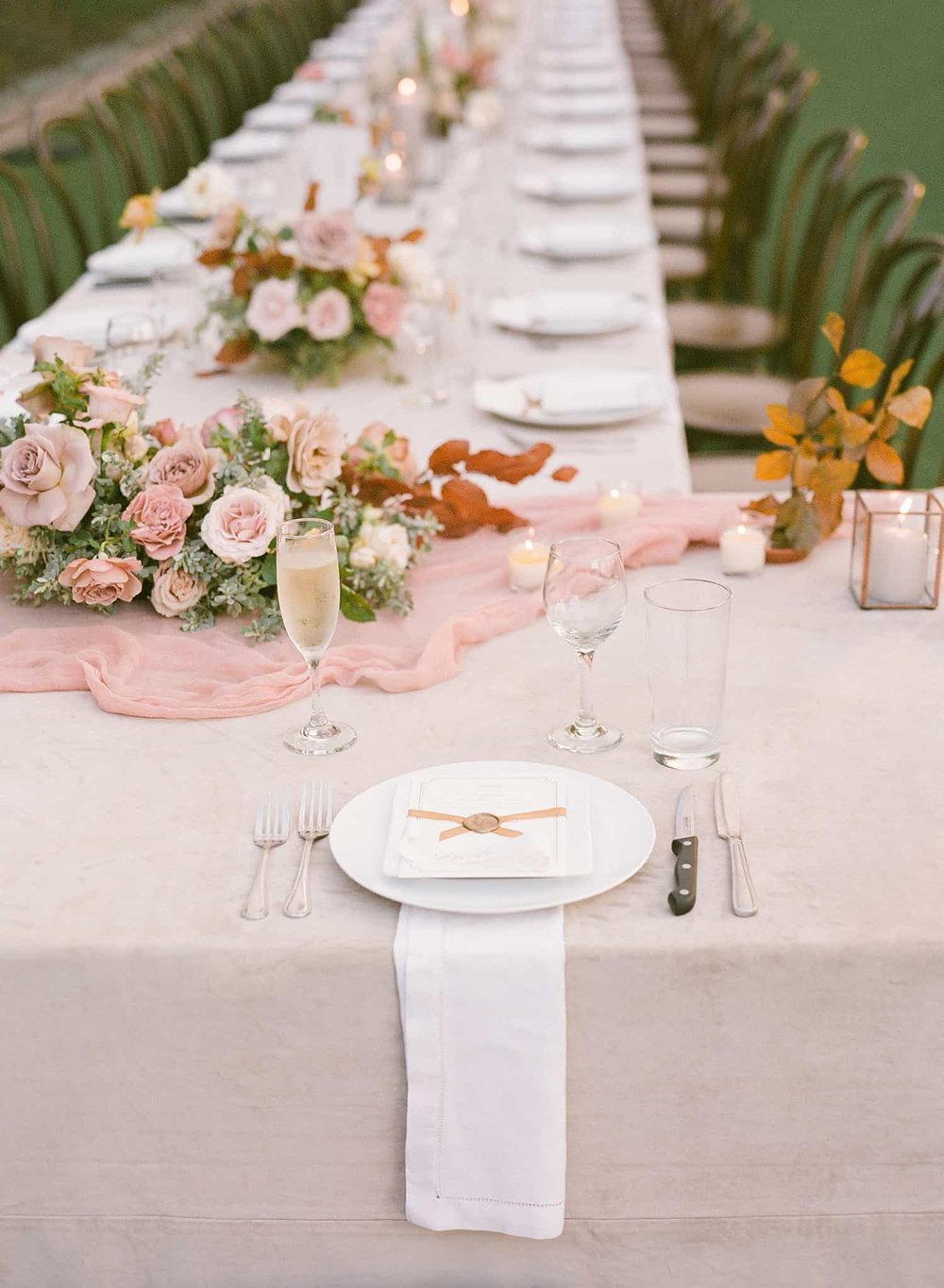 Flower arrangments at wedding reception by Color Theory Collective