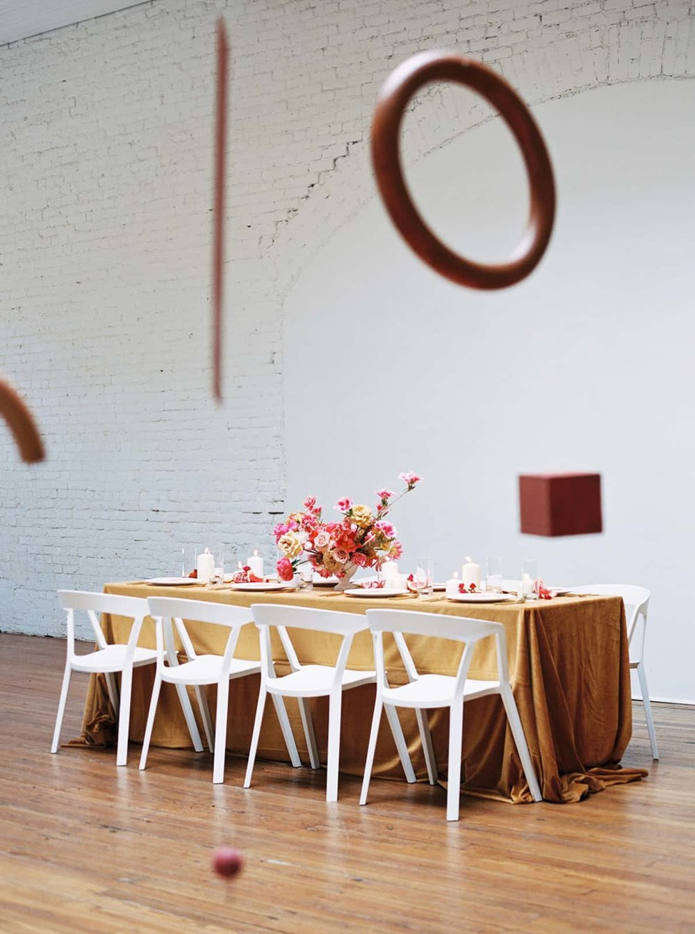Wedding reception florals designed by Color Theory Collective