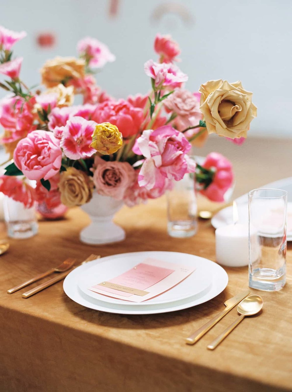Flower arrangements and placesettings designed by Color Theory Collective