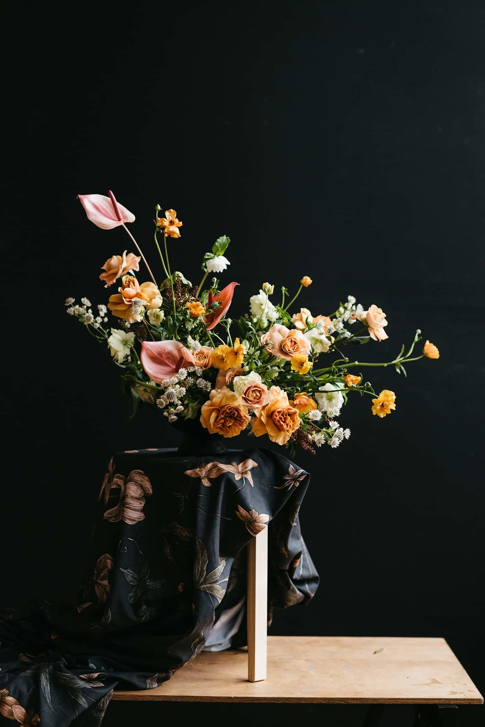 Floral designer and Portland florist Color Theory Collective demonstrates flower arranging.