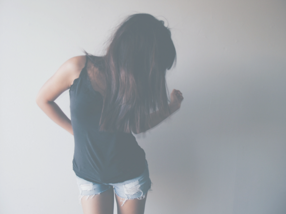 girl against a wall