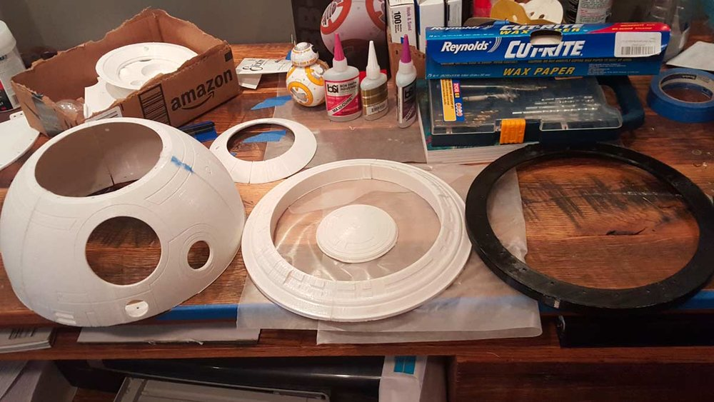 These are the 5 main pieces that make up the BB8-Builder's club dome.  Each of these pieces is actually composed of several sub-pieces as you saw in the earlier print pictures, but after assembly you end up with; the Dome (left), The Skirt (middle), The Top (inside Skirt), The Dome Ring (right), and the Pie Panel (back).