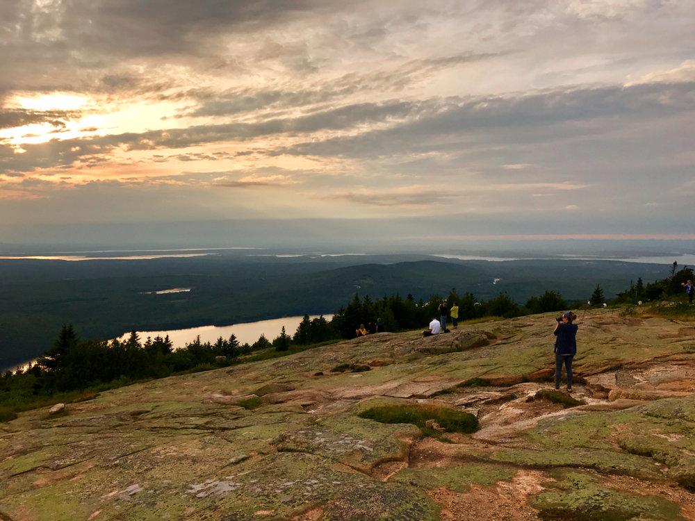Capturing the sunset atop Cadillac Mountain.