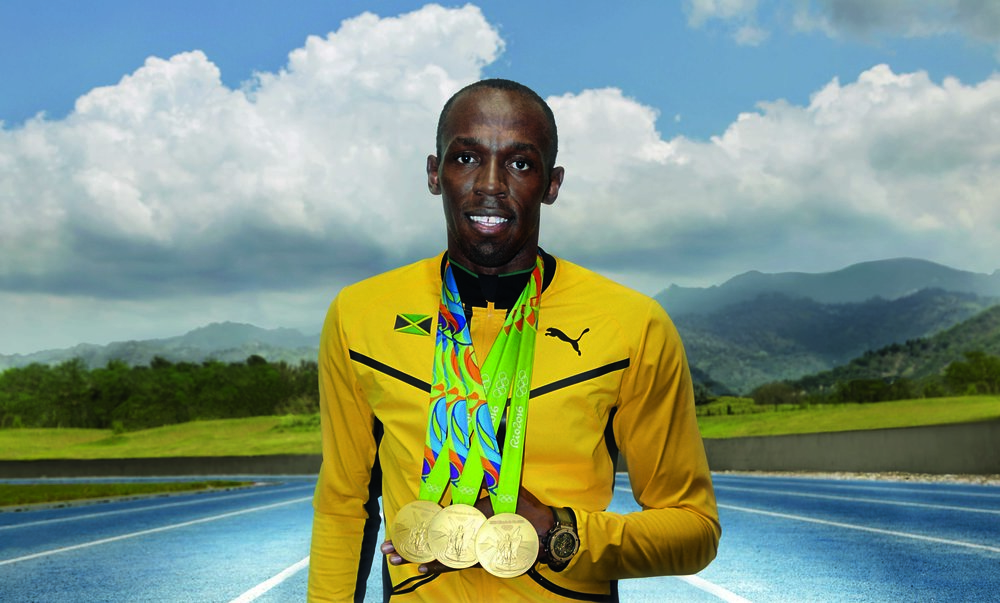 the-legend-usain-bolt-with-his-3-gold-olympic-medals.jpg