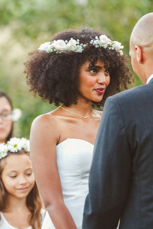 No idea if I'm going to let my hair grow out for our wedding, but if so, love the all-white, minimal flower grown.