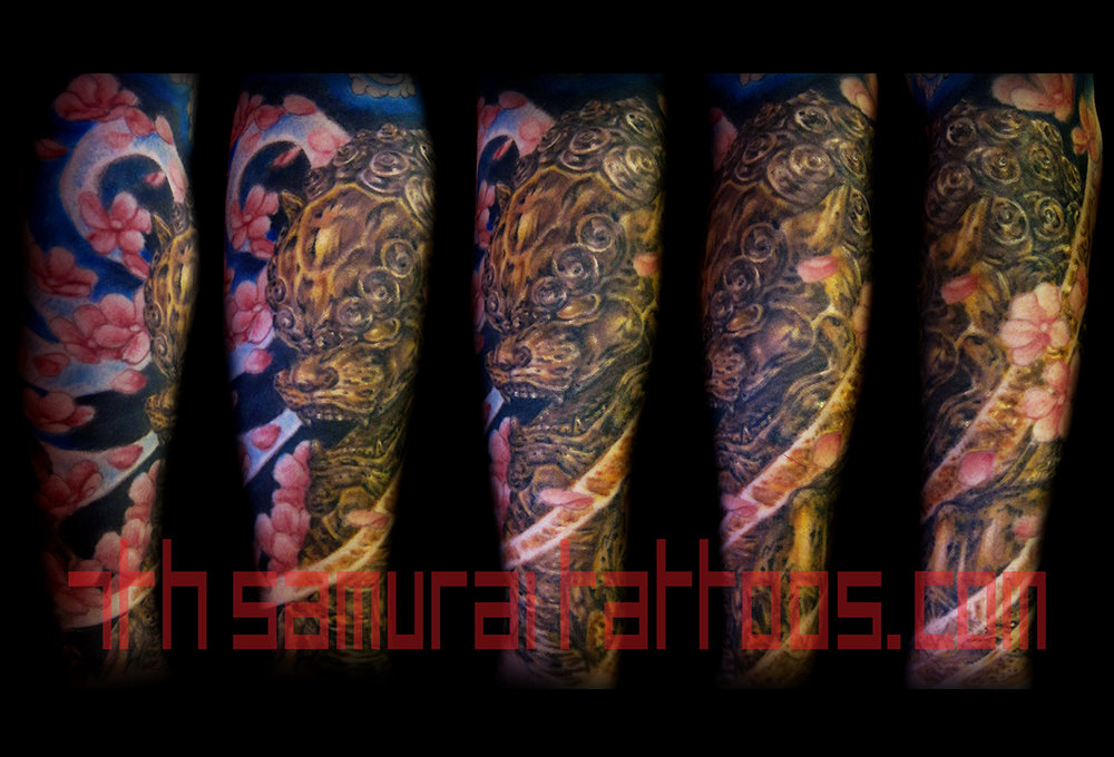 Gold Fudog Statue with Cherry Blossoms. Kai 7th Samurai men's arm color tattoo
