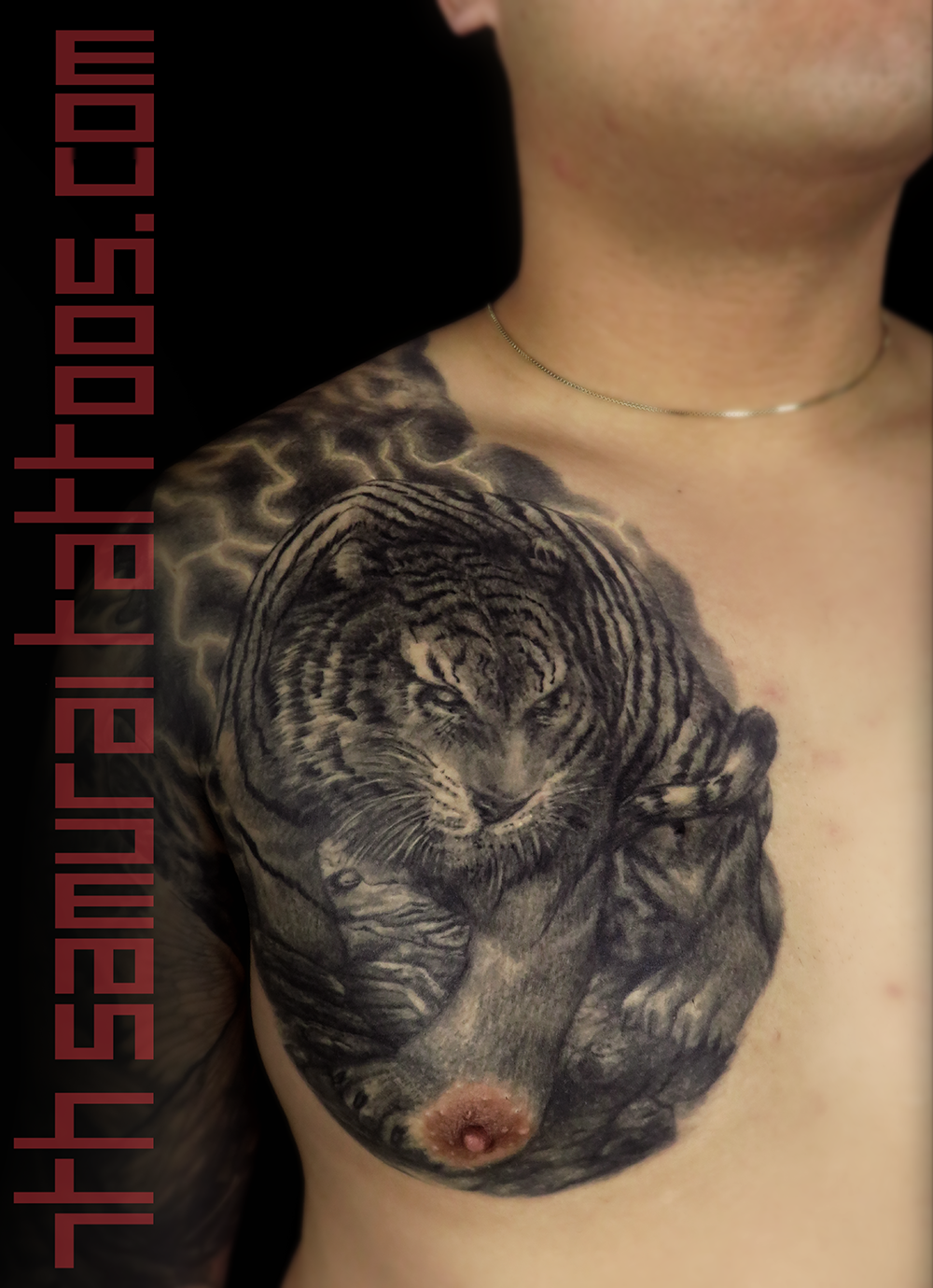 Men's asian tiger with lightning chest piece tattoo 1.png