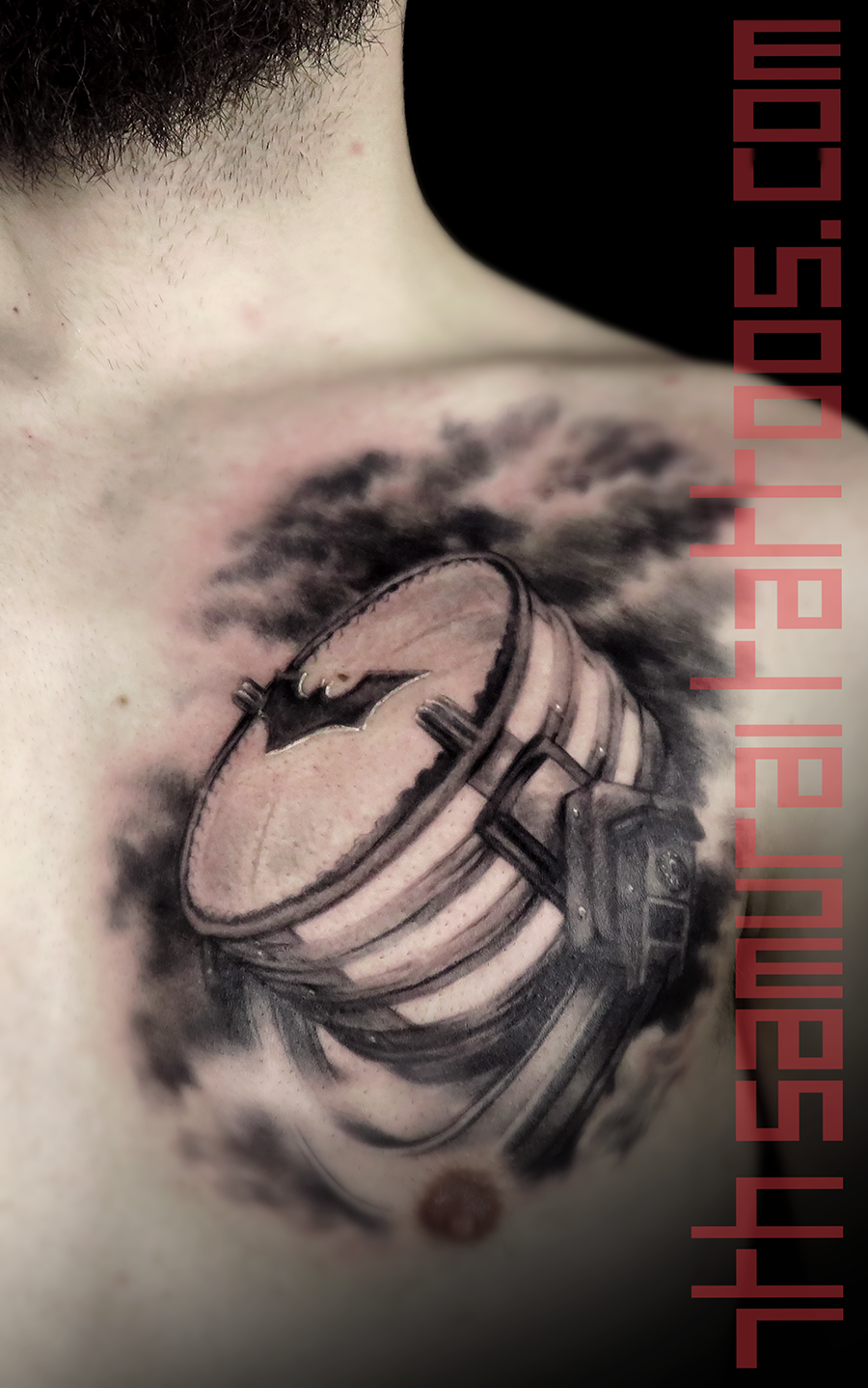 Men's Batman Batsignal spotlight clouds chest piece tattoo.png