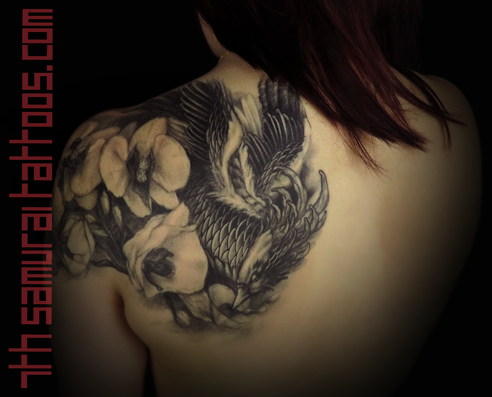 Woman's asian phoenix with orchids upper shoulder back piece tattoo 4.png