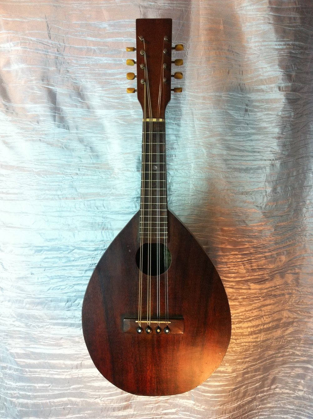 A pleasure to meet this old fella! Perhaps the only all Koa, Kamaka tear drop mandolin.