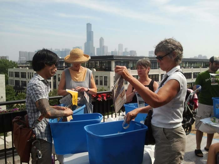 As part of a brunch, attendees learn about worm composting and building their own bins.