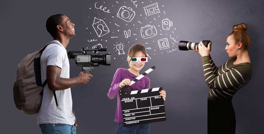 Two young people with cameras and a kid with a clapboard, ready to enter the contest.
