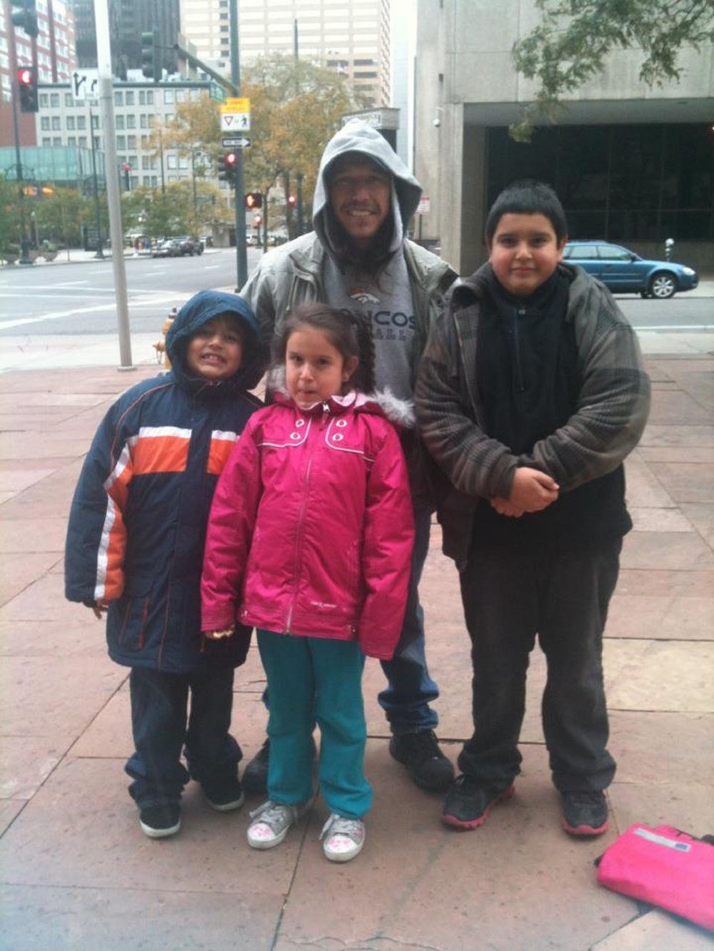 Styling with their new coats, this Denver family appreciates the dhms for our part in making it happen.