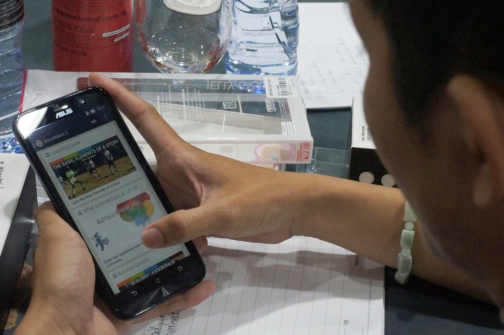 A participant of the citizen media training reviews the lessons on his smartphone.   (Photo: Loa)