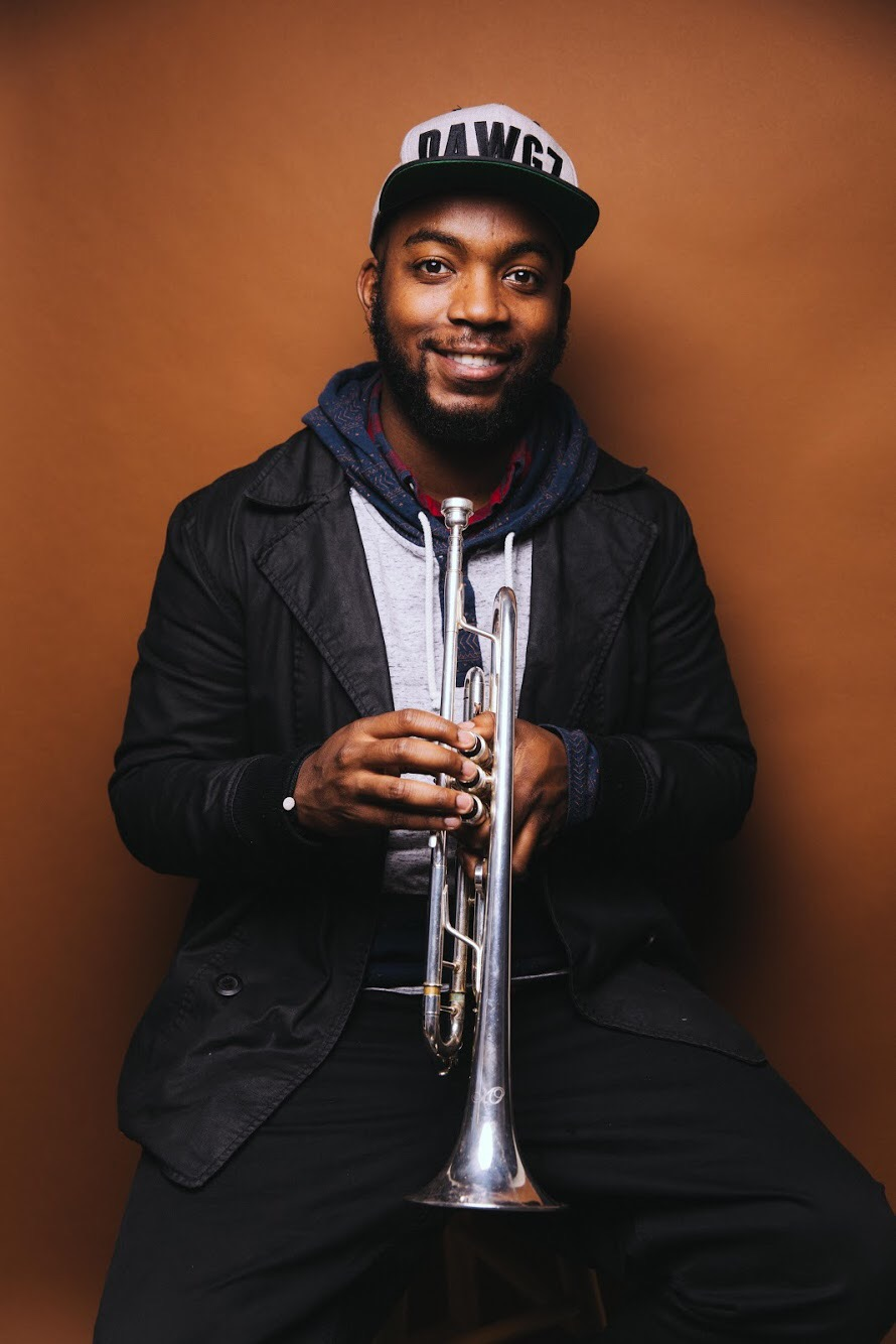 Aaron Eaddy,  Trumpet / Lead Vocals    Aaron Eaddy, Trumpet/Lead Vocals, is an electrical and audio engineer from Hartford, CT. He graduated from the University of Connecticut with a Bachelor of Science in Electrical Engineering, taking a full time position at General Dynamics Electric Boat as a Systems Engineer. Aaron is currently the head audio engineer at Gold Club Records Studios and has helped craft a signature sound for the label. He also writes original music. Notably as a composer, he has copyrighted music and commercial placements.