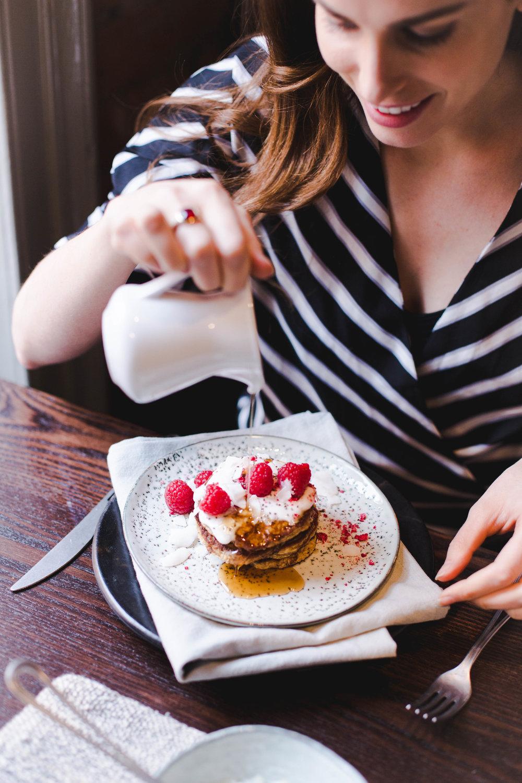 vegan pancakes with raspberries on top