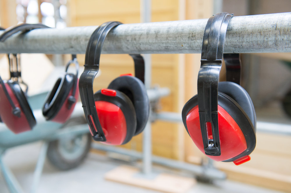 stock-photo-headphones-hanging-in-a-row-for-hearing-safety-131682089.jpg