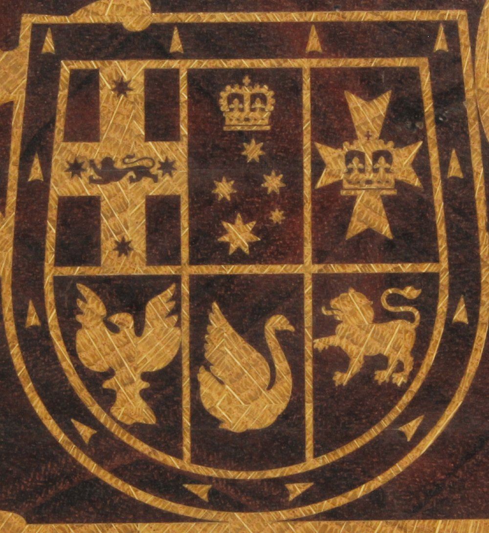 A close up of the Australian coat of arms board above